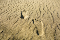 footprints-sand-two-left-right-secluded-beach-golden-32966465